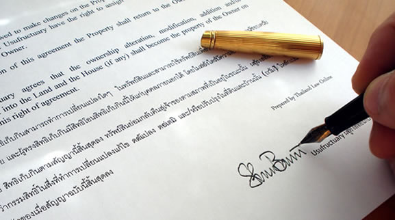 close-up of signing Thai English usufruct contract